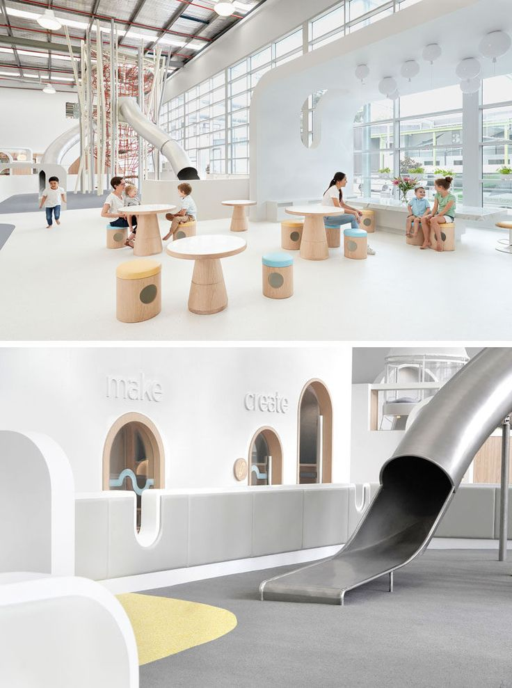 The main room of this modern play center has an area for parents to sit and watch their children play on the climbing structure and slides.