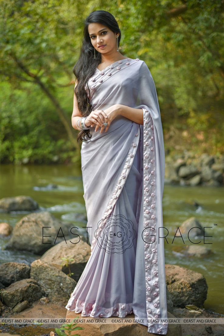 PRICE: INR 10,411.00; US$ 157.74 To buy click here: https://www.eastandgrace.com/products/winterland Featuring the Winterland saree in grey, 100% flat, pure silk chiffon with baby pink synthetic raw silk trimming that is reminiscent of the winter wonderlands, frozen and magnificent. The signature-style adorable baby pink ribbonwork baby pink roses promise a memorable look for your next soirée. Reach us at care@eastandgrace.com. With Love, EAST & GRACE www.eastandgrace.com