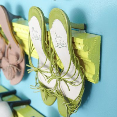 DIY Idea: A Very Creative Shoe Storage Idea From 'Living In A Nutshell'. Using strips of molding to organize her heels on a wall.