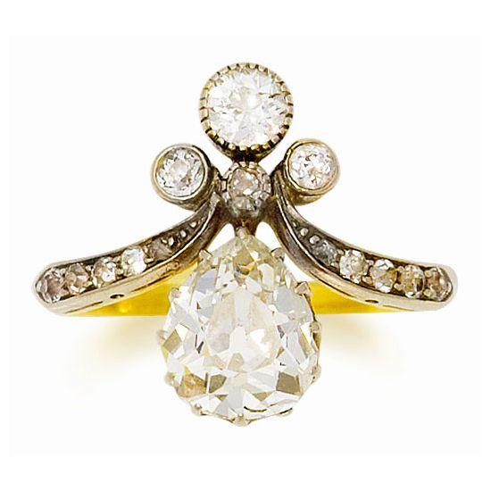An Edwardian diamond ring, circa 1900 The pear shaped diamond with an old brilliant–cut diamond surmount and tapering diamond shoulders, circa 1900