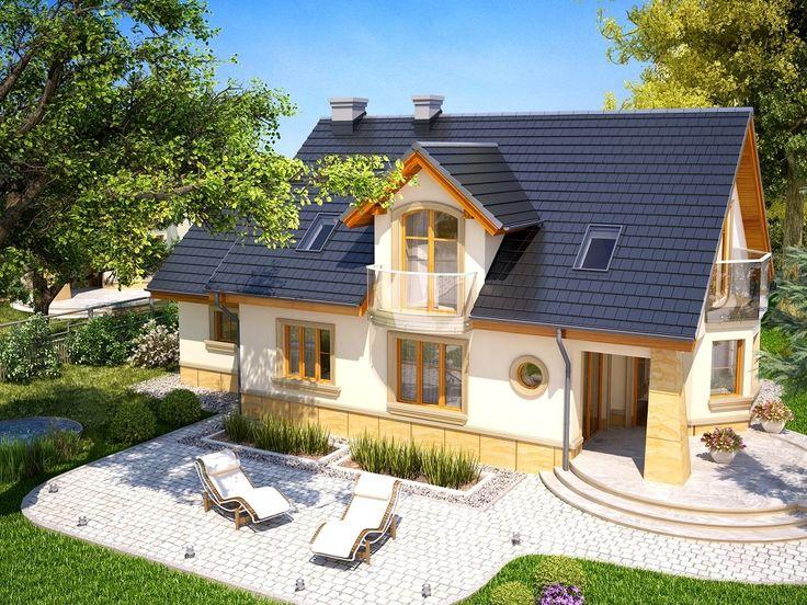Atrakcyjny dom o bryle głównej przykrytej dachem dwuspadowym.