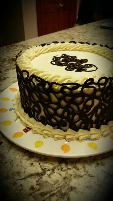 3 layer chocolate cake with chocolate mousse,  white chocolate buttercream and a chocolate cage.