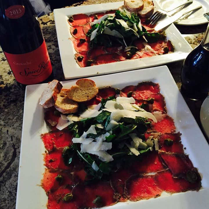 It's lunchtime at La Grapperia and our Carpaccio has just been served! Thinly sliced fillet, drizzled with lemon and extra virgin olive oil. Topped with capers, rocket and Parmesan shavings. Wine pairing: Spice Route Grenache 2013. Cheers Dears! #Carpaccio #LightLunch #LaGrapperia #SpiceRoutePaarl #Cheers