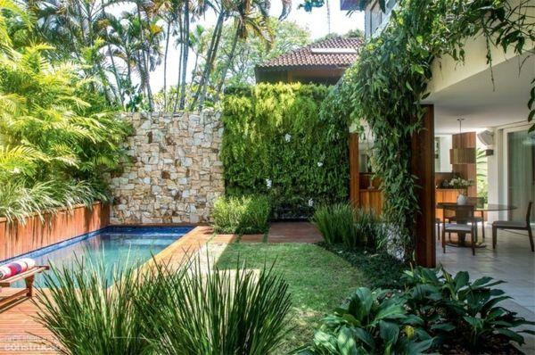 Natursteinmauer Garten bepflanzen moderne Sichtschutz Ideen