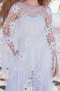 Crochet gold: Poncho thin as a spider's web!
