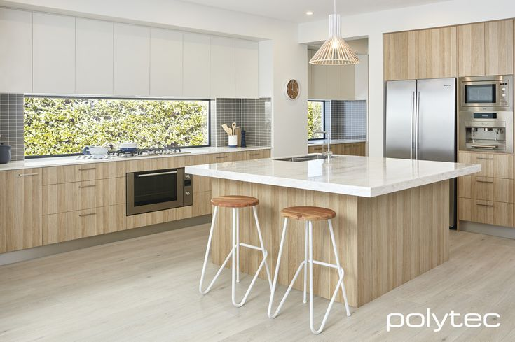 Polytec - Doors and panels in RAVINE Natural Oak. Overhead doors in MELAMINE Classic White Matt. http://www.polytec.com.au/products/kitchen/evolution-range/natural-oak-ravine-embossed-wood-grain/
