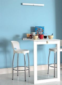 A fold-down kitchen table can serve as an eating space or an extra counter while cooking.