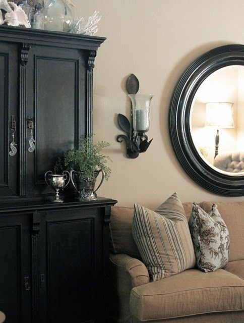 Love this look!  Black Furniture, tan walls, love the white accessories with glass! Niccceee