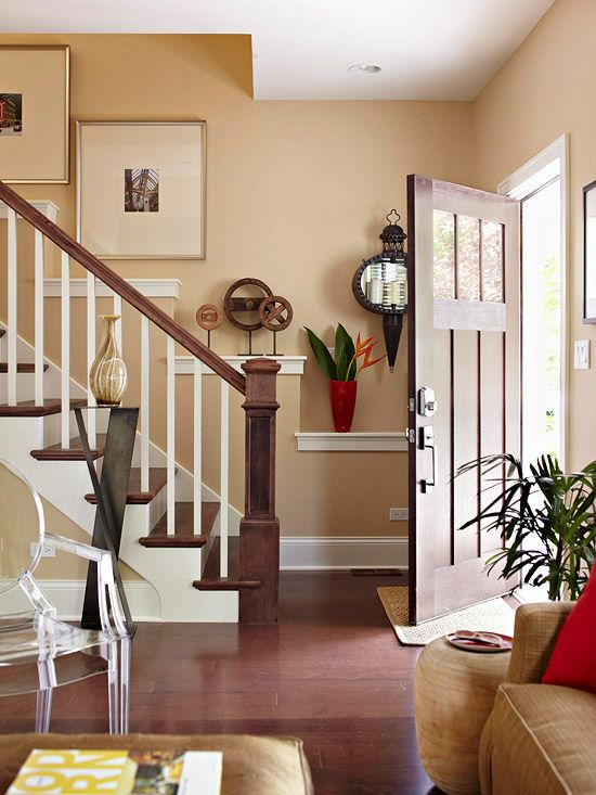 love the wall behind the staircase--cool idea. gives an opportunity for more dimension with little shelves in addition to photos or artwork on the wall
