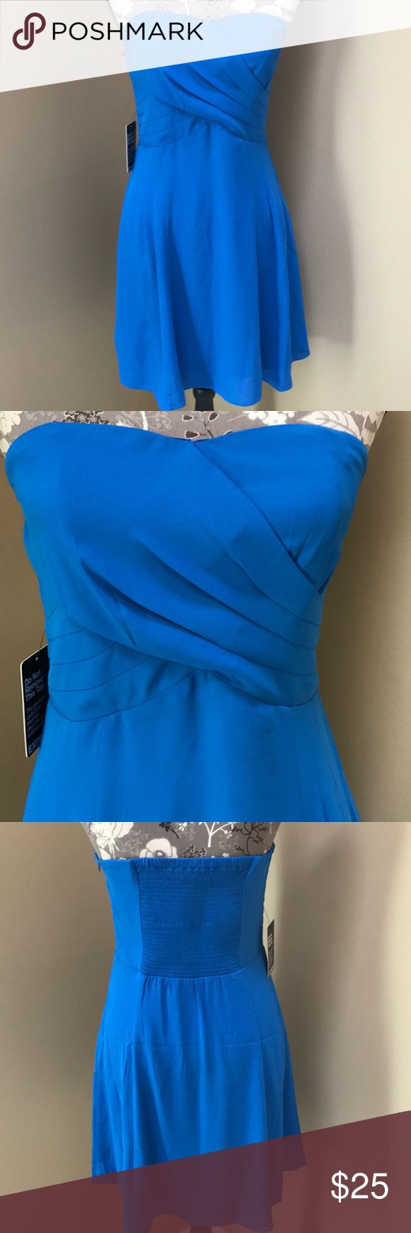 """NWT Express Strapless Mini Dress NWT Express Strapless blue Mini Dress size 6. Super cute dress with pleats and side zip. Lined.14"""" across the chest and 28"""" long.  Great for upcoming dances. Express Dresses"""