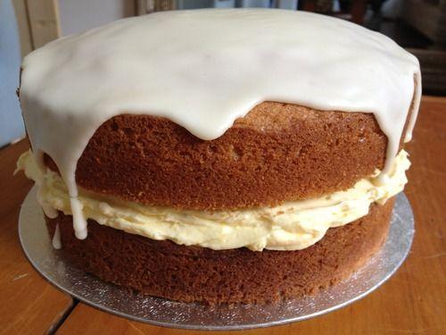 Orange cake with zingy orange buttercream filling & an orange glaze