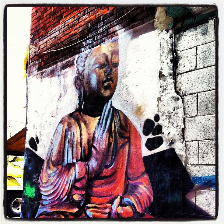 A piece on a wall in Kensington Market, Toronto. Street art. Graffiti art.