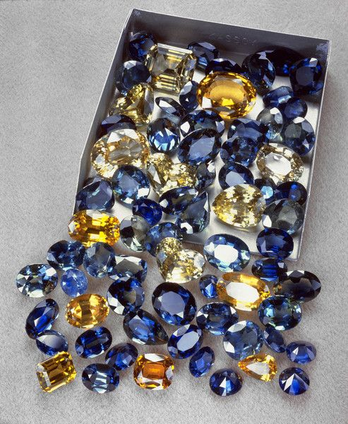 Here's a range of blue & gold coloured sapphires cut in a variety of shapes, from the New England district of NSW.