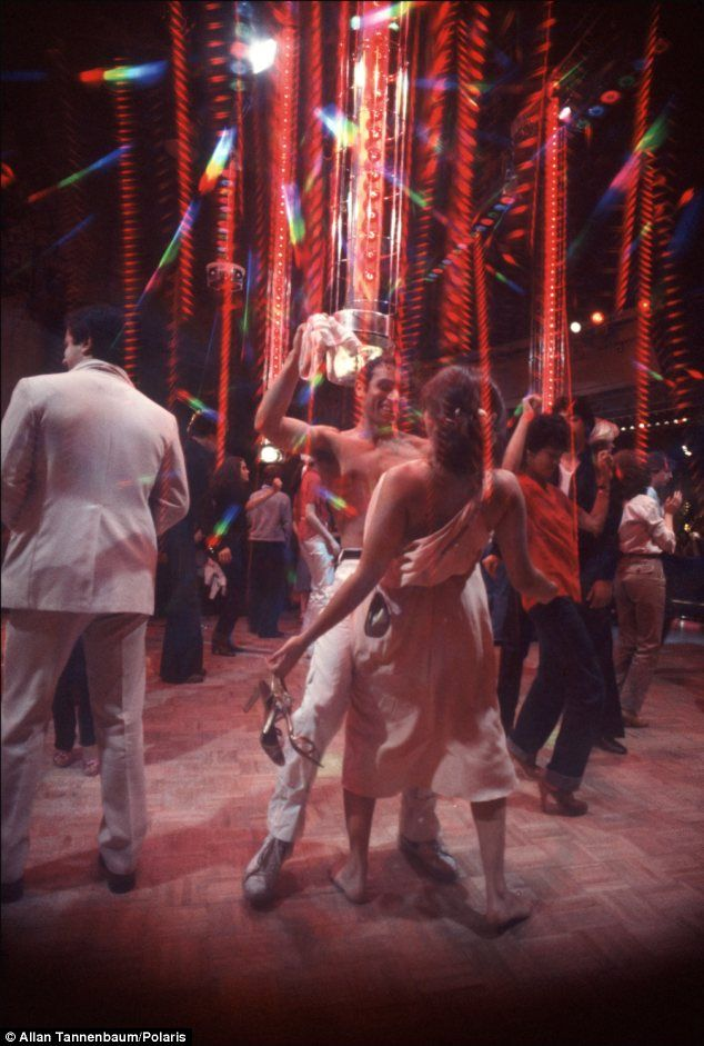 Shirt off: A dancer at Studio 54 removes his shirt mid-Disco...