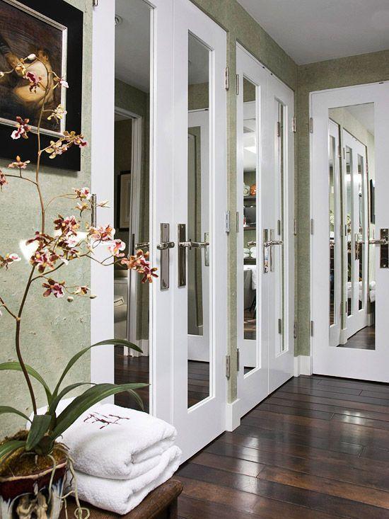 Update Closet Doors.  Mirrored doors, dark wooden floors, and an orchid! Pretty!