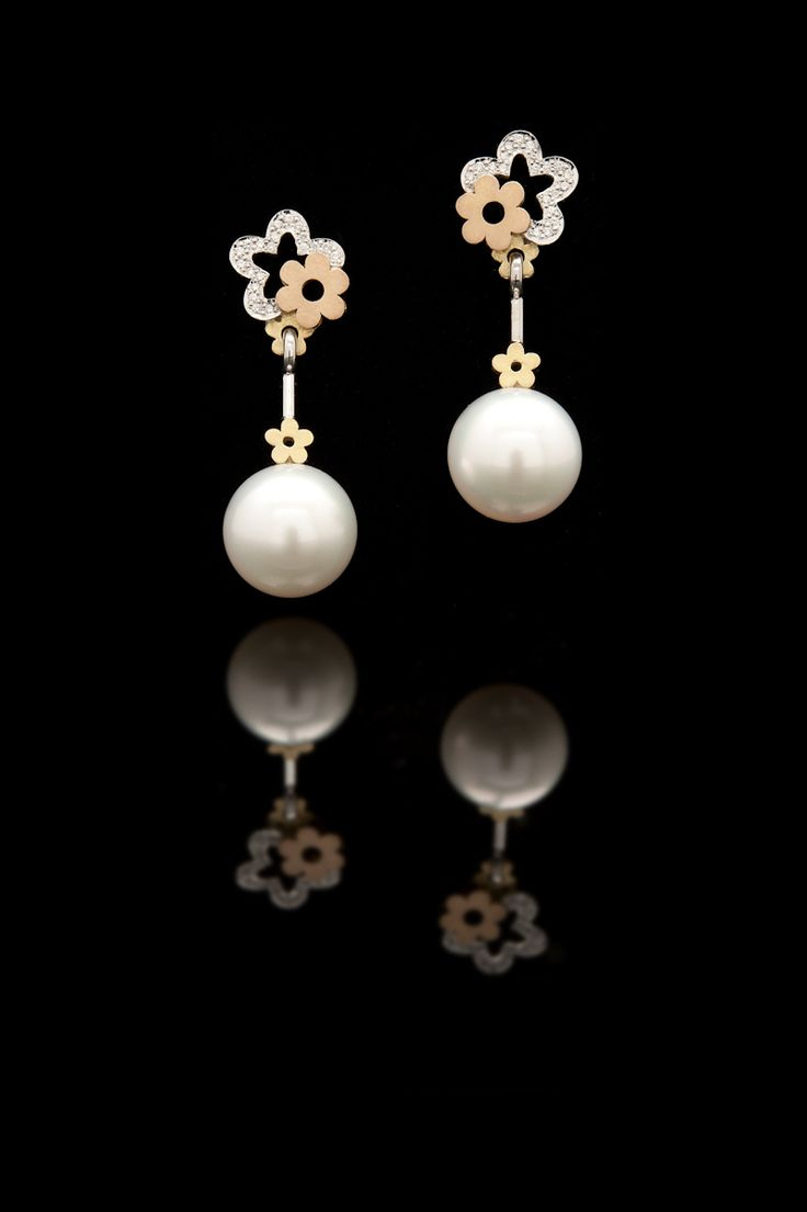Elegant and distinctive, these South Sea pearl Flower drop earrings will stand the test of time and be sure to amaze forever. What girl doesn't like pearls.