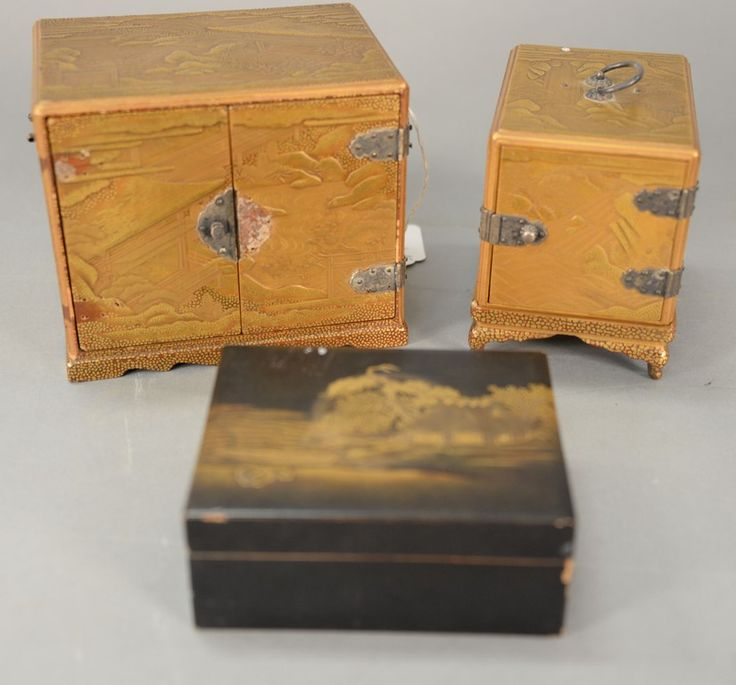Three Japanese lacquer pieces including two miniature chests with silver hinges and decorated with mountains, one chest on stand with three drawers behind one door and the other chest with four drawers behind two doors (one chest door lock is seperate but available) and small black box decorated with house on shore (imperfections) along with original receipts from 1962 Japan G. Tahara Co., stating each are over 150 years old, small box signed.