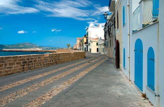 Alghero, Sardinia. Alghero is the only place in Italy where a Catalan dialect is spoken, though locals also speak Italian and are friendly to visitors. Photo by fauxware/Shutterstock.