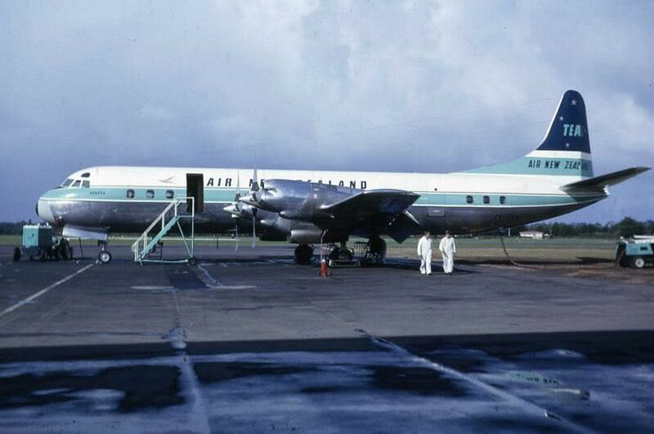 """Air New Zealand Lockheed L-188C Electra ZK-CLX """"Akaroa"""" on the ramp at Auckland-Whenuapai, circa July 1965. The Air New Zealand name had been launched in April 1965 and this aircraft carries a hybrid livery that still includes the previous TEAL name on the tail. ZK-CLX was purchased from Qantas to replace ZK-TEC (also named """"Akaroa""""), which had been written off in a bizarre training accident at the same aerodrome, 27th March 1965."""