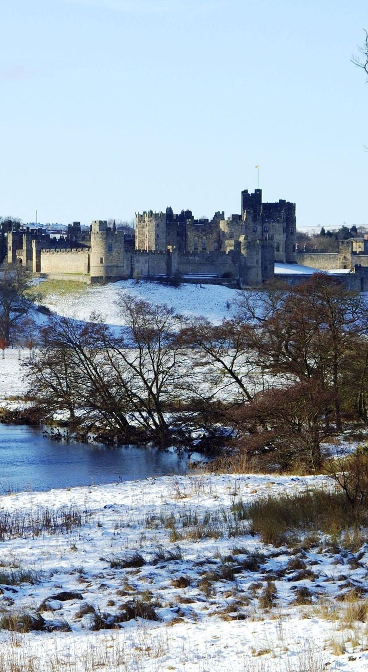 Alnwick Castle by river Aln in Winters Snow | The 20 Most Stunning Fairytale Castles in Winter