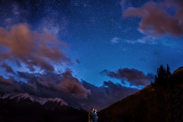 Starry night portrait from a mountain engagement session.