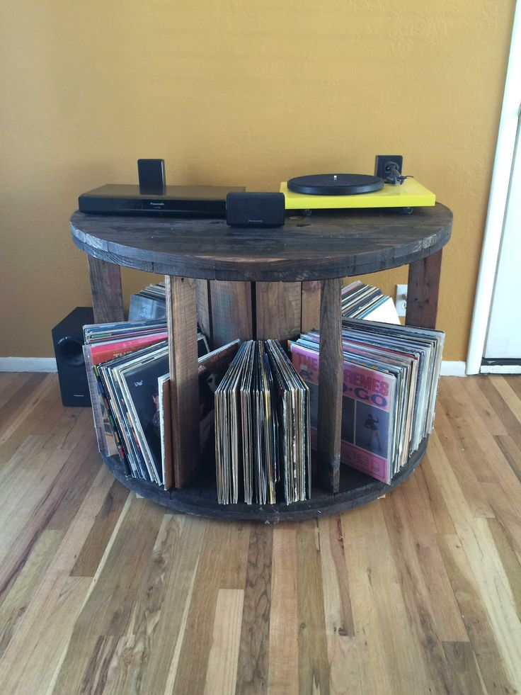 #LivingRoom, #Music, #PalletDiyIdeas, #RecyclingWoodPallets, #Storage I used a single wire spool to make the table. One pallet was used to construct the dividers underneath the table top. The entire project took about two hours to build not counting the staining.
