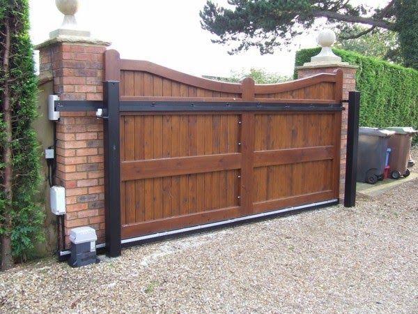 Cosas de casa octubre 2013 portones hierro forjado for Puertas de madera para garage