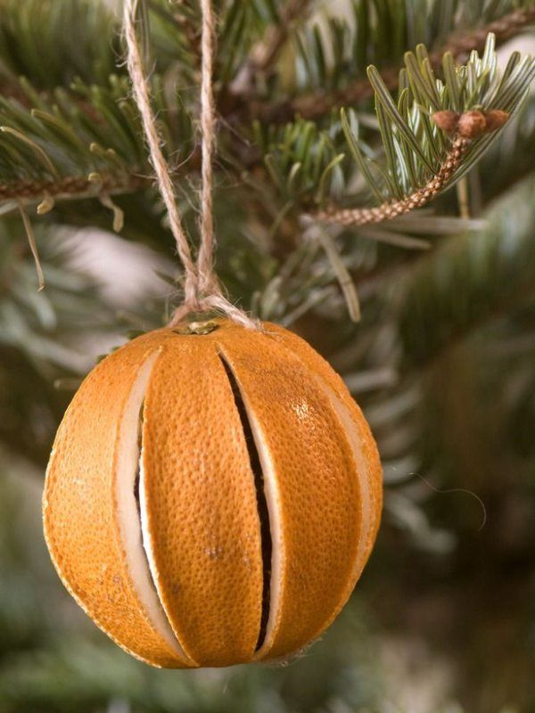Dried oranges smell wonderful! Slit the sides of an orange just as in the photo below, and bake on a very low heat for 2 hours. Loop some string through the top and tie to the tree. The house will smell great for days to come!