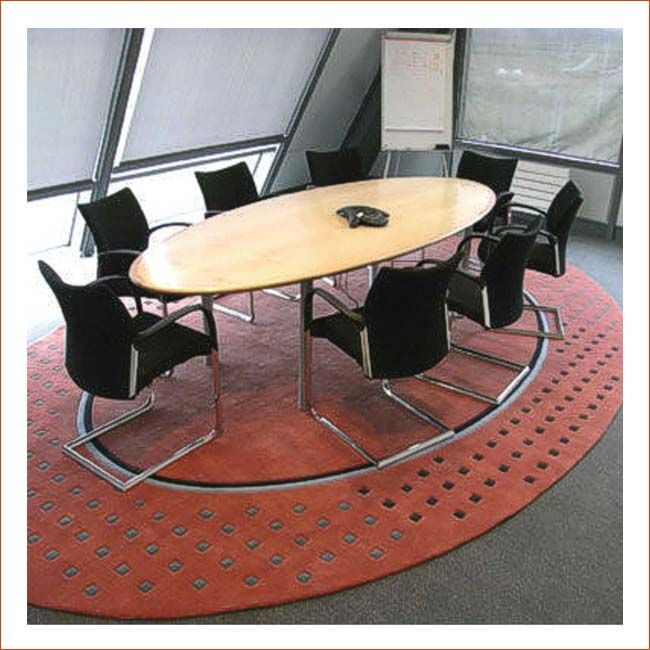 This modern design wool rug sets this boardroom apart.