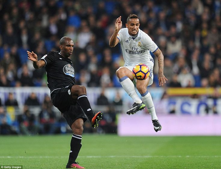 Real Madrid defender Danilo brings down the ball acrobatically in front of former Liverpool winger Ryan babal