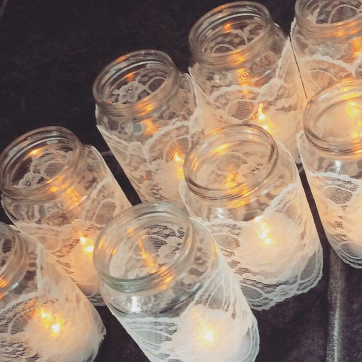 Wedding decor! DIY bride! I made these lace jar candle holders out of old baby food jars and secured the lace down with PVA glue. Very easy, very cheap and very effective.