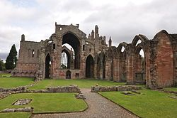 Melrose Abbey, Melrose, Roxburghshire, Scotland- a partly ruined monastery founded in 1136 by Cistercian monks on the request of King David I of Scotland. It was the chief house of that order in the country until the Reformation. The abbey is known for its many carved decorative details, including likenesses of saints, dragons, gargoyles and plants.