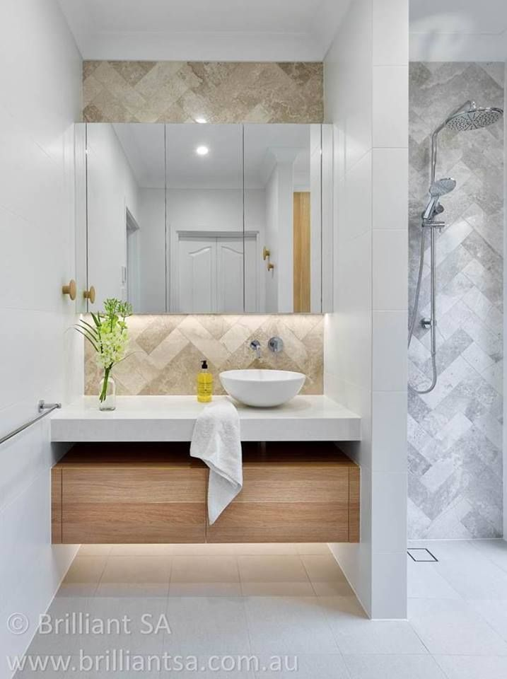 Showcasing our silver travertine in a recent bathroom renovation by Brilliant SA. Silver travertine's beauty lies in its unique colour, toning and textural variation. Display this unique tile in a herringbone pattern is a great option for creating a strong focal point, whether it be splashback or a feature wall tile.
