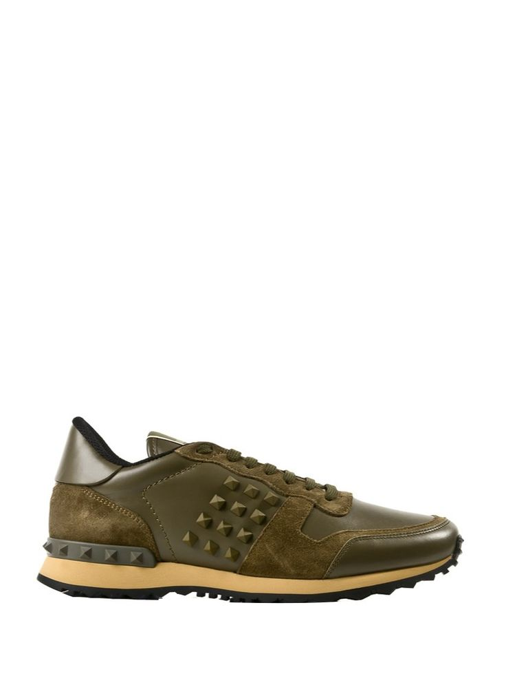 Icon sneakers from Valentino Garavani with lateral rubber studs. Crafted from soft kaki green suede and leather they look great with chino pants and boxy t- shirt but match them also with tailored jackets for your special events.