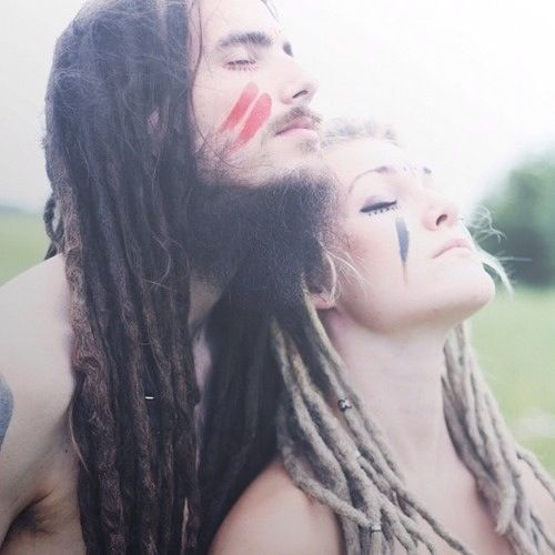 Hippie couple wearing face paint