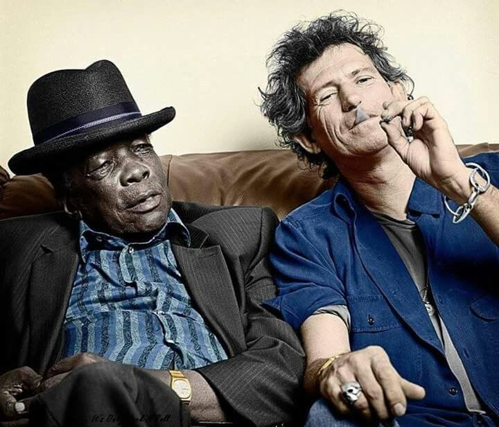 John Lee Hooker and Keith Richards ~ the blues greats were almost unknown in there own country, in the 60s, until young British rock musicians like the Stones and Eric Clapton started playing with them at there concerts. The blues world owes a debt of gratitude to a bunch of white British rockers for its own existence and relevance today.