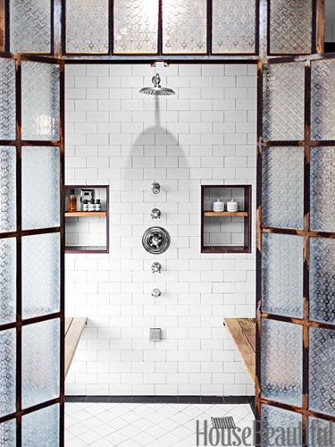 Shower fixtures, from the Astaire collection by Newport Brass, are arranged in a line.