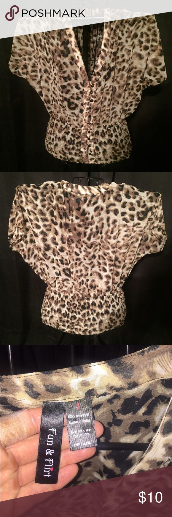 Cheetah Print Shirt Cheetah print shirt. Brand new without tags. Buttons start at the bust down to the waste. Sheer material. The bottom is stretchy and fitted to the waste line. Size small. Fun & Flirt Tops Blouses
