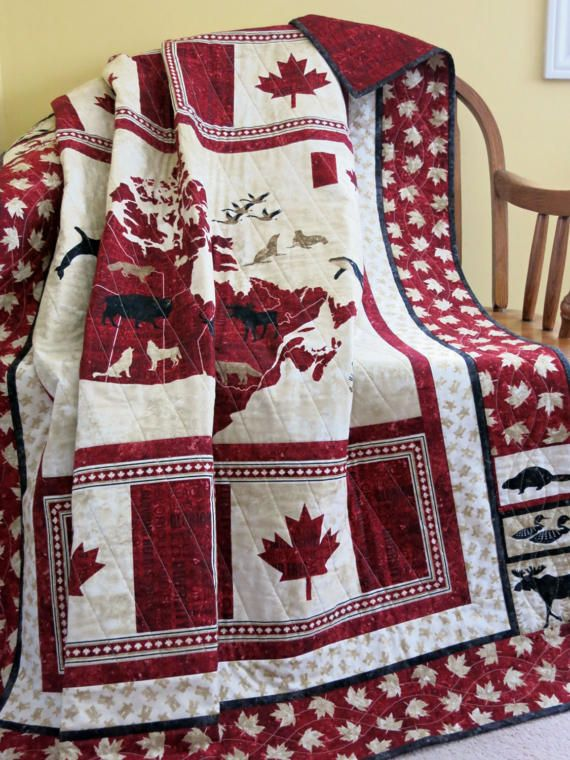 An awesome quilt to celebrate Canadas 150 Birthday! A red, beige and black heirloom featuring a map of Canada, the majestic Canadian flag and Canadian icons such as the beaver, common loon, moose, a canoe and Canadian geese. The backing is a collage of shades of black patriotic words with a marbled red background. 100% quilters quality cotton, pre-washed Top quality low loft cotton batting Machine quilted Care directions;  * cold water wash, gentle cycle with mild soap  * semi-dry on low…