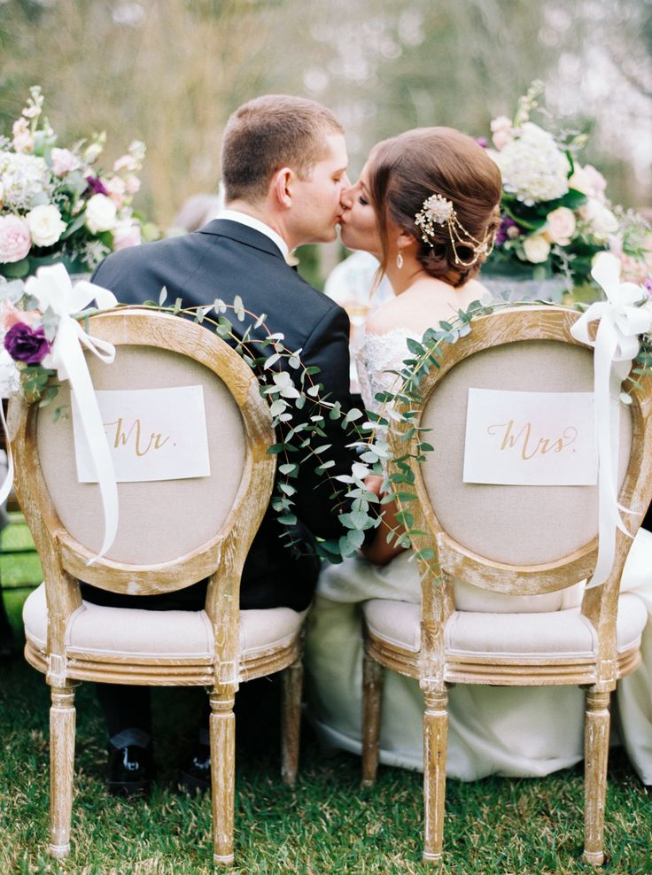 upholstered outdoor seating for bride and groom   Photography: Erich McVey