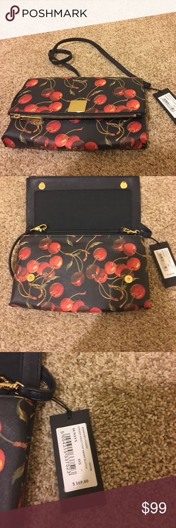 Ted Bake London Cherry Handbag w/ Duster NWT Ted Bake London Cherry Handbag w/ Duster NWT, never got around to using.  I have matching cherry dress in size 3 that I will post at a later date or ask me about it. Ted Baker London Bags Mini Bags