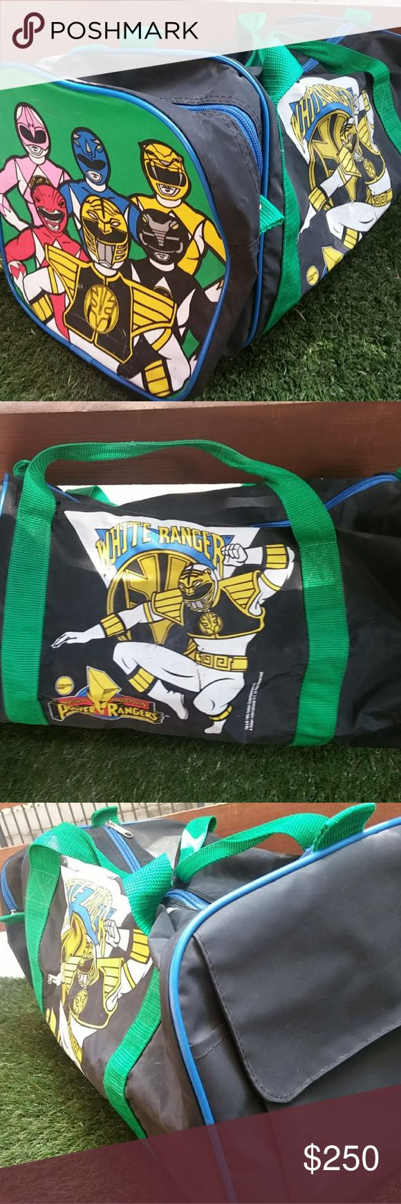 Vintage 1995 Power Rangers Duffel Bag by SABAN Ent Officially licensed by 1995 SABAN Entertainment, this is a Power Rangers duffel bag. It features a White Ranger on its main zipper side, and the rest of the colorful Power rangers crew on its side pockets. This one in particular has 2 zippers and one velcro pocket. ALL zippers and pockets are fully functional. Very minimal fading. Normal wear and tear on inside. Might of been a kids gym bag. Amazing conversation piece. Overall good…
