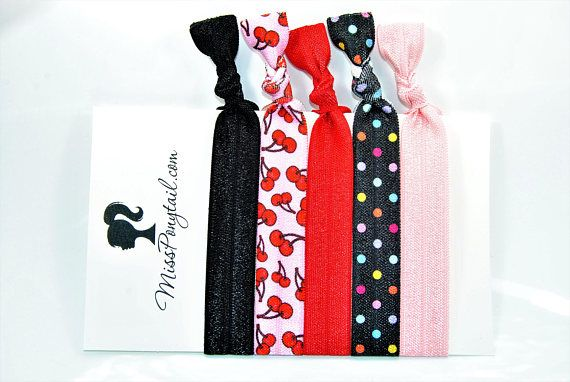 ELASTIC HAIR TIES: Trendy Elastic Ponytail Holders Handmade with Fold Over Elastic. Tie Your Hair Back, Its HOT! THIS LISTING INCLUDES: _________________________ • 1 Solid Black Hair Tie • 1 Light Pink w/Red Cherries Hair Tie • 1 Solid Red Hair Tie • 1 Black with Colorful Dots