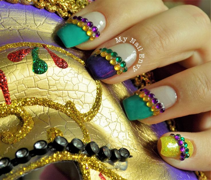 Mardi Gras Nails – My Nail Envy  Carnival nails, mardi gras nails, green purple and gold nails, rhinestones, mardi gras beads, glitter
