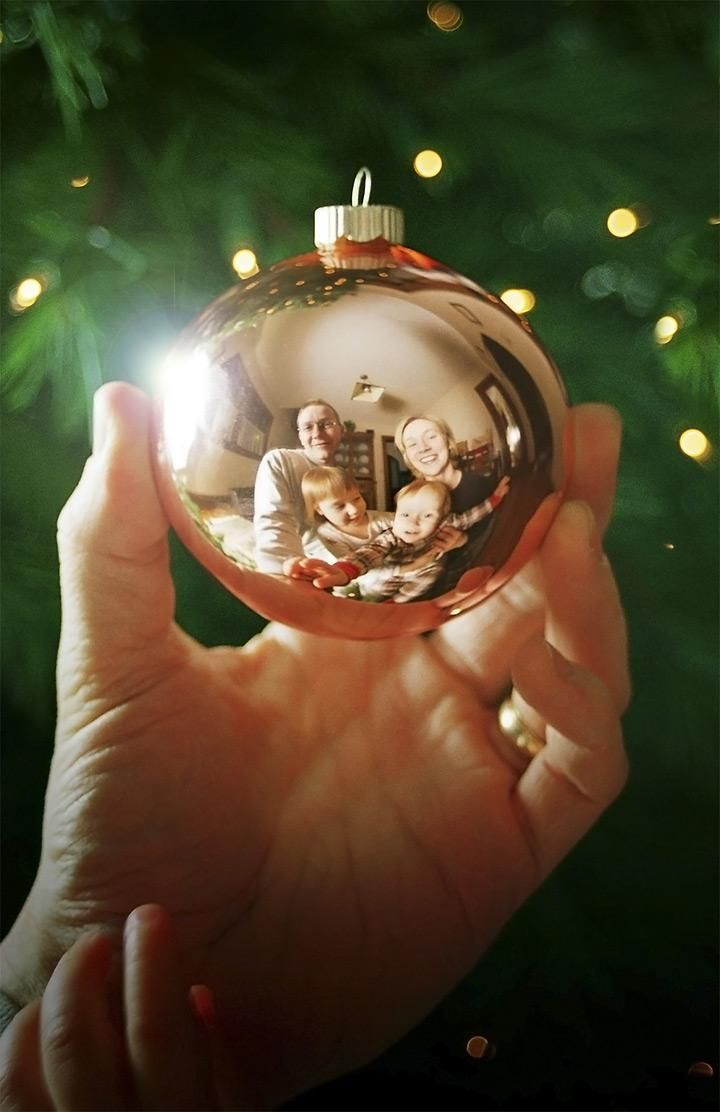 Capture your family's reflection in a Christmas ornament!  Tip: use Photoshop to remove the camera from the reflection.