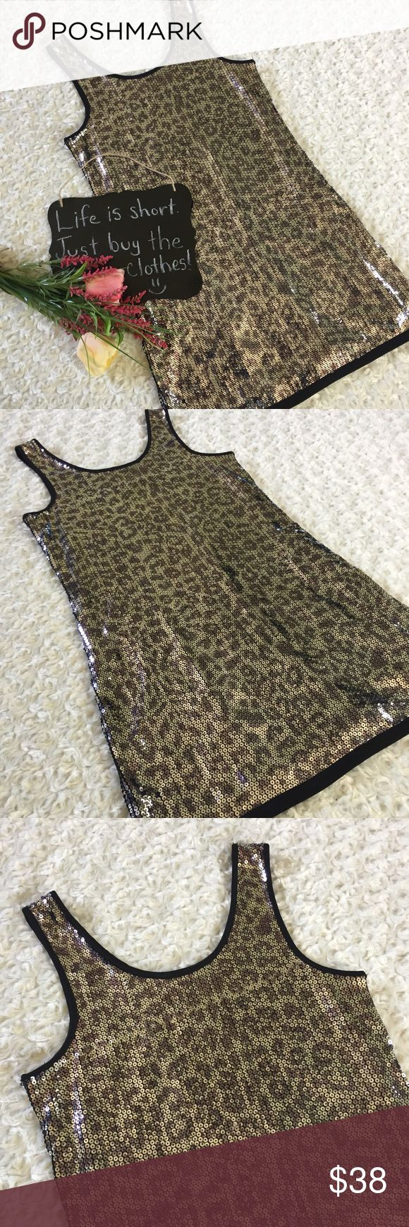 """Romeo and Juliet Couture sequin dress Very fun sequin animal print dress by Romeo and Juliet Couture!! In person it's a bit more Silver bc of the sequins. Size M. 16"""" arm pit to arm pit. 31.5"""" length. Romeo & Juliet Couture Dresses Mini"""