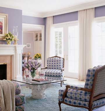 Option to cover my sliding glass doors... The rods for these ample white drapes sit behind a cornice that matches the room's molding, creating a clean, crisp look. At night, when the drapes are drawn, the white wall of fabric will look as soothing as the daytime view.