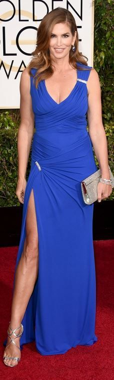 Cindy Crawford in Versace gown, Jimmy Choo shoes, and Harry Winston jewelry at the Golden Globes, January 11, 2015