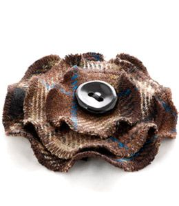 This attractive corsage made from the National Trust for Scotlands exclusive tweed is stylish and easy to wear. The corsage features a ceramic button with a kilt pin fastening. This tweed has been designed and woven exclusively for the National Trust for Scotland by Johnstons of Elgin. The product is handmade in the Outer Hebrides by Paulette Brough using the original Trust tweed.  Only £9.99