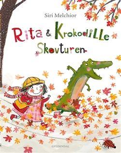 """Køb 'Rita og Krokodille - Skovturen' bog nu. """"Når vi kommer ud i skoven, er det virkelig vigtigt, at du bliver på stien, Krokodille!"""" siger Rita. """"Ellers kan"""